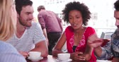 four people : Group Of Friends Sitting In Coffee Shop Chatting Stock Footage