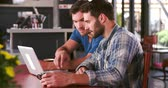 barba : Two Men In Cafe Working On Laptop Together
