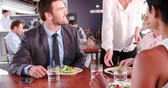 três : Three Businesspeople Having Working Lunch In Restaurant Stock Footage