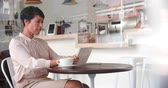 local : Businesswoman at a table in a cafe using tablet computer
