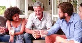 patio : Group Of Friends At Home On Patio Talking Together Stock Footage