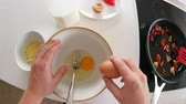 pimentas : Point of view of man preparing ingredients for an omelette