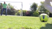 ponto : Male Multi-Generation Family Playing Football In Garden