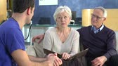três : Senior Couple Meeting With Surgeon In Hospital Stock Footage