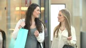 aquisitivo : Two Female Friends Shopping In Mall Together