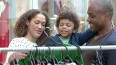 trilho : Family Looking At Clothes On Rail In Shopping Mall Vídeos