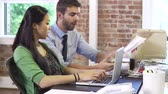 funky : Two Businesspeople Working In Design Studio Together Stock Footage