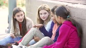 quatro : Four Young Girls Hanging Out Together In Park