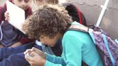 três : Young Boys Using Digital Tablets And Mobile Phones In Park