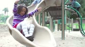se divertindo : Slow Motion Sequence Of Children Playing On Slide Stock Footage