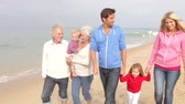 atlamacı : Multi Generation Family Walking Along Beach Together