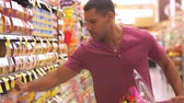 консервы : Man Shopping In Supermarket