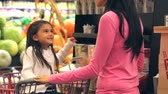 aborrecido : Mother And Daughter Shopping In Supermarket