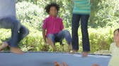 tendo : Group Of Children Jumping On Trampoline