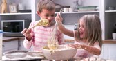 смешивание : Slow Motion Shot Of Children Having Messy Fun In Kitchen