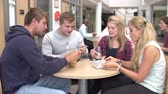 years : Group Of College Students Eating Lunch Together