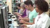eğitim : Group Of Mature Students Working At Computers Stok Video