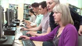 estudantes : Group Of Mature Students With Teacher Working At Computers