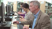 estudantes : Group Of Mature Students Working At Computers Stock Footage