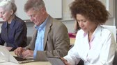 tabuleta digital : Mature Students Working In Further Education Class