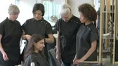 estudantes : Teacher Training Mature Students In Hairdressing Class Stock Footage