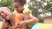 tendo : Slow Motion Sequence Of Granddaughter Hugging Grandmother