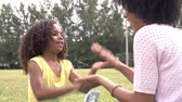 years : Mother And Daughter Playing Clapping Game In Park Together Stock Footage