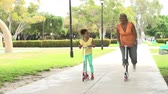 tendo : Grandmother And Granddaughter Riding Scooters In Park Vídeos