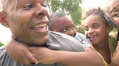 tendo : Grandparents Giving Grandchildren Piggyback Ride In Garden