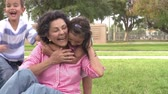desfrutando : Slow Motion Shot Of Grandmother With Grandchildren In Park