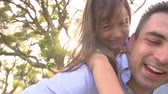 se divertindo : Slow Motion Shot Of Father Giving Daughter Piggyback Ride