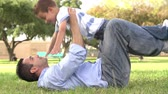 tendo : Slow Motion Shot Of Father Playing With Son In Park