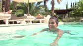 tendo : Slow Motion Shot Of Woman Exercising In Swimming Pool