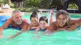 inflável : Grandparents With Grandchildren On Airbed In Swimming Pool Vídeos