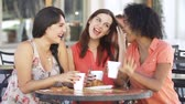 lifestyle shot : Three Female Friends Meeting In Café
