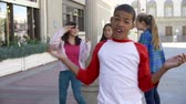 atitude : Group Of Teenage Children Posing For Camera In Slow Motion Stock Footage