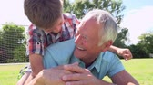 vnuk : Slow Motion Shot Of Grandfather And Grandson With Football