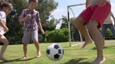 pontapé : Family Playing Football In Garden Together