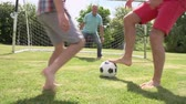pontapé : Grandfather, Grandson And Father Playing Football In Garden