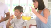 выстрел : Family Eating Breakfast In Kitchen Together