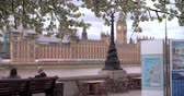 clock : London, spring, Houses of Parliament from Albert Embankment Stock Footage