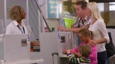 bilhete : Family Going On Vacation Checking In At Airport Shot On R3D