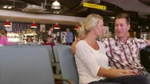 aeroporto : Couple Waiting In Airport Departure Lounge Shot On R3D Vídeos