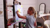 quadro : Young Girl Working On Painting In Studio Shot On R3D Camera