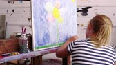malovat : Young Girl Working On Painting In Studio Shot On R3D Camera
