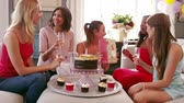 queque : Female Friends Celebrating Birthday At Home Shot On R3D