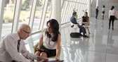 building : Business Meetings In Busy Office Foyer Area Shot On R3D Stock Footage