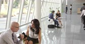 businesswoman : Business Meetings In Busy Office Foyer Area Shot On R3D Stock Footage