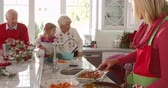 basting : Family With Grandparents Prepare Christmas Meal Shot On R3D