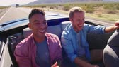 automóvel : Two Male Friends On Road Trip In Convertible Car Shot On R3D